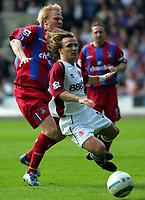Fotball<br /> Premier League 2004/05<br /> Crystal Palace v Middlesbrough<br /> 2. april 2005<br /> Foto: Digitalsport<br /> NORWAY ONLY<br /> Crystal Palace's Aki Riihilahti tackles middlesbrough's Bolo Zenden