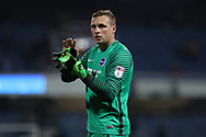 David Stockdale applauds the fans at the final whistle of the EFL Sky Bet Championship match between Queens Park Rangers and Brighton and Hove Albion at the Loftus Road Stadium, London, England on 7 April 2017.