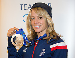 © Licensed to London News Pictures. 25/02/2014. London, UK. Womens snowboard bronze medalist, Jenny Jones poses with her medal at the Sofitel Hotel at Heathrow Airport on 24th February 2014. Photo credit : Vickie Flores/LNP