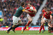 George North of Wales holds off Eben Etzebeth of South Africa. Rugby World Cup 2015 quarter final match, South Africa v Wales at Twickenham Stadium in London, England  on Saturday 17th October 2015.<br /> pic by  John Patrick Fletcher, Andrew Orchard sports photography.