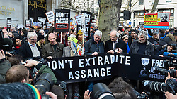 © Licensed to London News Pictures. 22/02/2020. LONDON, UK.   VIPs, including Vivienne Westwood (3L), John Shipton (father of Julian Assange) (2R), Roger Waters from Pink Floyd (R), pose for the media ahead of a march from Australia House in Aldwych to Parliament Square in support of Wikileaks founder Julian Assange.  The full extradition trial of Mr Assange begins in London on 24 February.  Photo credit: Stephen Chung/LNP