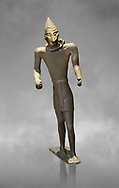 Hittite bronze figure with a mask, Hittite Period. Adana Archaeology Museum, Turkey. Against a grey art background .<br /> <br /> If you prefer to buy from our ALAMY STOCK LIBRARY page at https://www.alamy.com/portfolio/paul-williams-funkystock/hittite-art-antiquities.html . Type - Adana - in LOWER SEARCH WITHIN GALLERY box. Refine search by adding background colour, place, museum etc<br /> <br /> Visit our HITTITE PHOTO COLLECTIONS for more photos to download or buy as wall art prints https://funkystock.photoshelter.com/gallery-collection/The-Hittites-Art-Artefacts-Antiquities-Historic-Sites-Pictures-Images-of/C0000NUBSMhSc3Oo