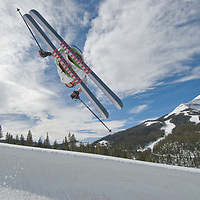 Ben Wiltsie (MR) skis aerial manouvers and flips in half pipe in terrain park at Big Sky Ski Resort, near Bozeman, Montana. 11,166-foot Lone Mountain is in bkg. of most pictures.