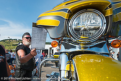 Checking out the new bike models at the Harley-Davidson display during the Annual Sturgis Black Hills Motorcycle Rally. SD, USA. August 8, 2014.  Photography ©2014 Michael Lichter.