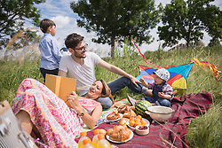 Family enjoying picnic in the countryside, Bavaria, Germany