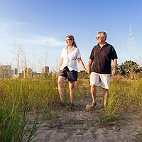 Northwestern Researchers Teresa Woodruff and Tom O'Halloran walk on a beach in Chicago