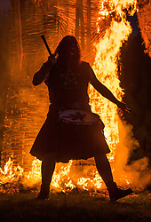 © Licensed to London News Pictures. 05/05/2018. Chalton, UK. A member of the 'Pentacle Drummers' perform as a 30 foot high Wickerman is burnt at The Beltain Festival at Butser Ancient Farm in Hampshire. Over two thousand people gathered to witness the ancient Beltain Celtic celebration of summer - which will culminates in the burning of the giant Wickerman.  Photo credit: Peter Macdiarmid/LNP