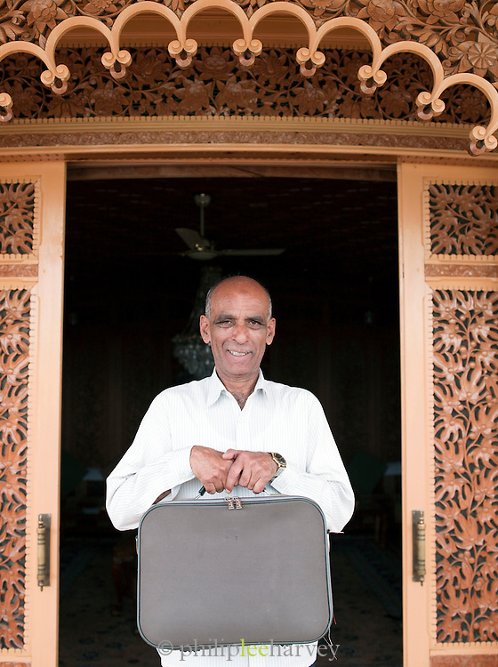 A travelling tailor at a hotel houseboat on Lake Dl, Kashmir, India