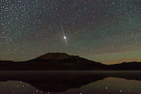 During the Perseid Meteor Shower a satellite flared brightly above Beartooth Butte.