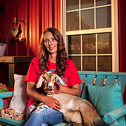 Angela Steele holds one of her goats at the family home near Purcell, Oklahoma. The Steele Family Farm has made a variety of goat milk based soaps and lotions since 2014. Nathan Lambrecht/Journal Communications