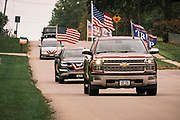 26 SEPTEMBER 2020 - DES MOINES, IOWA: People drive through Des Moines on their way to a motorcade supporting the reelection of President Donald J. Trump. More than 1,500 people in 500 vehicles participated in motorcade through Des Moines Saturday. They started in the suburbs south of downtown, drove through downtown, and ended at the State Capitol.       PHOTO BY JACK KURTZ