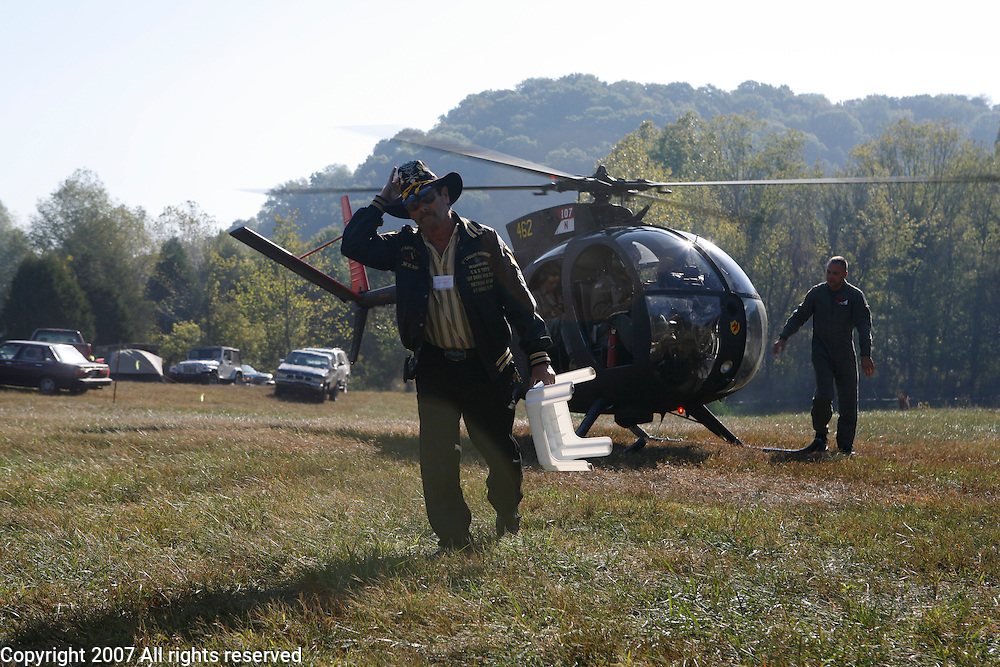 """Jim """"Blackie"""" Black, who served with the 1st Squadron, 9th Cavalry in 1967 and 1968 during the Vietnam War helps with Red Horse Aviation's OH-6 Loach during the Machine Gun Shoot at Knob Creek, Kentucky, October 12, 2007. The Vietnam era OH-6 Cayuse, was commonly called a Loach during the Vietnam War."""