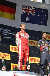 26.07.2015, Hungaroring, Budapest, HUN, FIA, Formel 1, Grand Prix von Ungarn, das Rennen, im Bild Sebastian Vettel (Scuderia Ferrari) geniesst die Sonne auf dem Podium // during the race of the Hungarian Formula One Grand Prix at the Hungaroring in Budapest, Hungary on 2015/07/26. EXPA Pictures © 2015, PhotoCredit: EXPA/ Eibner-Pressefoto/ Bermel<br /> <br /> *****ATTENTION - OUT of GER*****