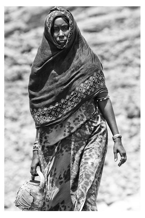 Woman carries water in Asaita Refugee Camp, Afar, Ethiopia 2016