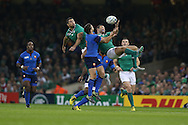 Ireland's Dave Kearney and Rob Kearney jump to claim a high ball away from Sebastien Tillous-Borde of France ©. Rugby World Cup 2015 pool D match, France v Ireland at the Millennium Stadium in Cardiff, South Wales  on Sunday 11th October 2015.<br /> pic by  Andrew Orchard, Andrew Orchard sports photography.