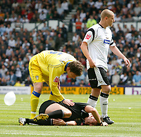 Photo: Steve Bond.<br />Derby County v Leeds United. Coca Cola Championship. 06/05/2007. Referee Phil Crossley lies seriously injured after an accidental collision with Seth Johnson (R)