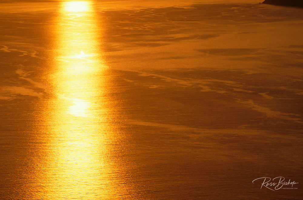 Golden evening sunlight reflected off the Pacific Ocean (aerial), Channel Islands National Park, California
