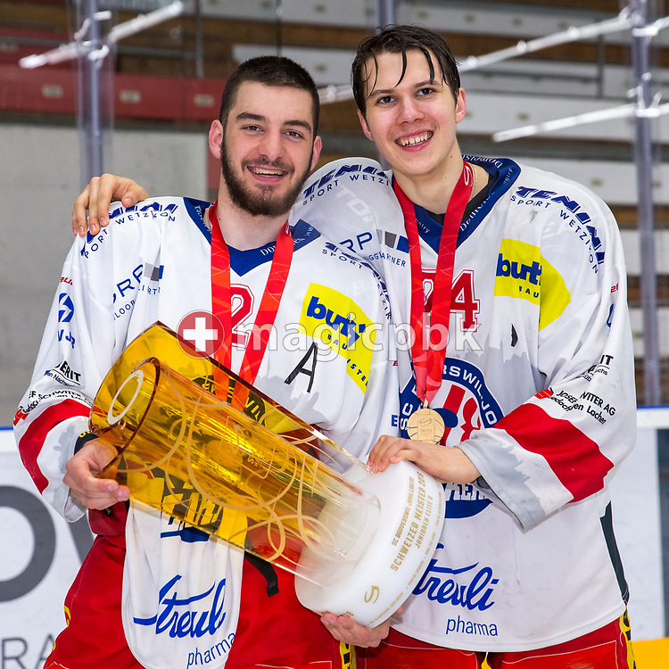 (L-R) Rapperswil-Jona Lakers players Joel Brotzge and Lars Mathis pose for a photo with the Swiss Champion trophy after winning ice hockey game 4 of the Elite B Playoff Final between EHC Chur Capricorns and Rapperswil-Jona Lakers in Chur, Switzerland, Friday, March 16, 2018. (Photo by Patrick B. Kraemer / MAGICPBK)