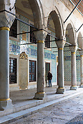 Tourist at Harem quarters and cloisters at Topkapi Palace, Topkapi Sarayi, of the Ottoman Empire, Istanbul, Turkey