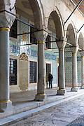 Tourist at Harem quarters and cloisters at Topkapi Palace, Topkapi Sarayi, of the Ottoman Empire, Istanbul, Turkey