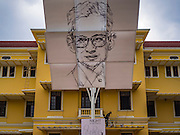 05 JANUARY 2017 - BANGKOK, THAILAND: A portrait of Bhumibol Adulyadej, the Late King of Thailand, hangs over the entrance to Siam Museum in Bangkok. After the King died on 13 October 2016, public buildings through out Thailand hung respectful portraits of His Majesty.     PHOTO BY JACK KURTZ