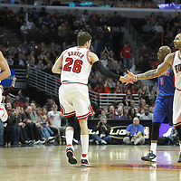 30 March 2012: Chicago Bulls shooting guard Kyle Korver (26) congrats Chicago Bulls power forward Carlos Boozer (5) as Chicago Bulls center Joakim Noah (13) goes back in defense during the Chicago Bulls 83-71 victory over the Detroit Pistons at the United Center, Chicago, Illinois, USA. NOTE TO USER: User expressly acknowledges and agrees that, by downloading and or using this photograph, User is consenting to the terms and conditions of the Getty Images License Agreement. Mandatory Credit: 2012 NBAE (Photo by Chris Elise/NBAE via Getty Images)