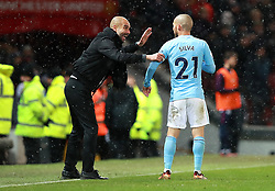 Manchester City manager Pep Guardiola (left) talks to David Silva (right)