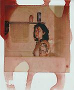 Self-portrait covered in menstrual blood.
