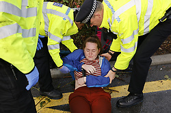 © Licensed to London News Pictures. 27/09/2021. London, UK. Insulate Britain climate activists are detained as they block a roundabout over the M25 motorway leading to Heathrow airport. Climate activists have vowed to continue their campaign of disruption despite the government being granted a temporary High Court Injucntion banning the group from protesting on the M25. Photo credit: Peter Macdiarmid/LNP