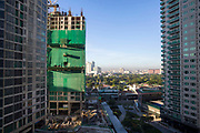 A view of Makati, with Garden Towers under construction on the left, and the Park Terraces building on the right on Palm Drive, Makati, Metro Manila, Philippines.