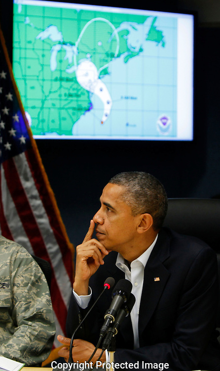 President Barack Obama listens to a briefing on Hurricane Sandy at FEMA Headquarters in Washington, DC on October 28, 2012.  Dennis Brack...