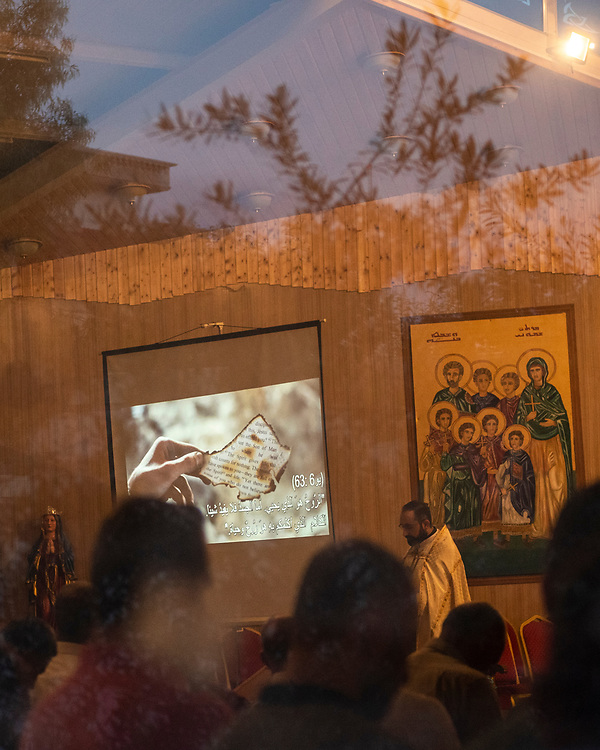 Ankawa, Iraq - May 18, 2017: Iraqi Christians worship at the Mart Shmoni church, a Syriac Catholic church in Ankawa, a suburb of Erbil, Iraq. Most of the parishioners are IDPs, pushed out of their homes in Qaraqosh during the 2014 ISIS advance.