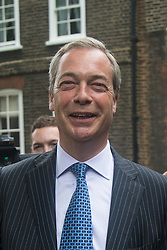 """Smith Square, Westminster, London, June 16th 2016. UKIP leader Nigel Farage launches his """"biggest ever"""" advertising campaign as Leave and Remain enter their last week of campaigning before the EU referendum on June 23rd. PICTURED: Nigel Farage remains in good cheer despite Remain campaigners disrupting yet another of his events."""