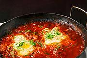 Shakshuka (Also Shakshouka, shakshoka, chakchouka) an Israeli dish made of cooked tomatoes, peppers, spices and eggs