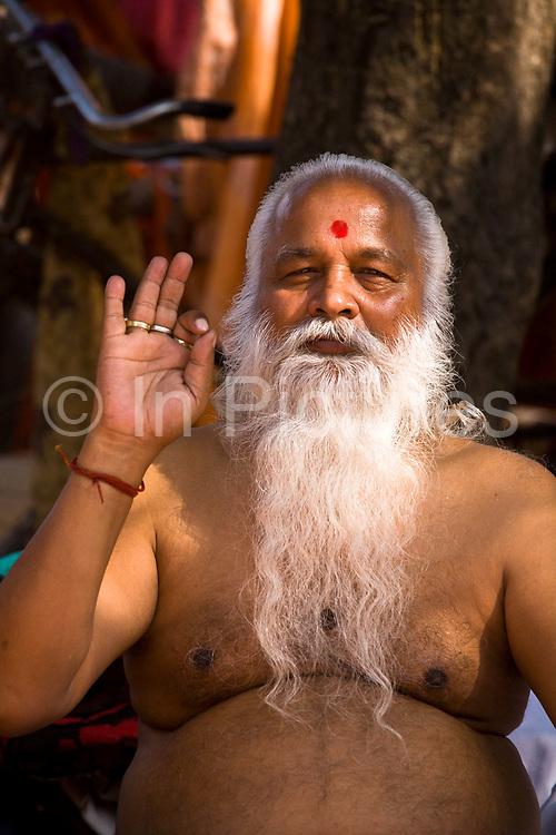 A pilgrim serenely grooms his long beared at the Sonepur animal fair, Bihar, India.