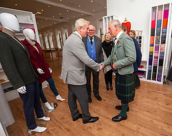 The Duke of Rothesay meets Jim Thomson, Hawico chairman, while he attended a reception in the workspace of the family owned and run business of Hawico, to celebrate British Industry in Hawick. Also present were local businesses from the initiative 'Famously Hawick'.