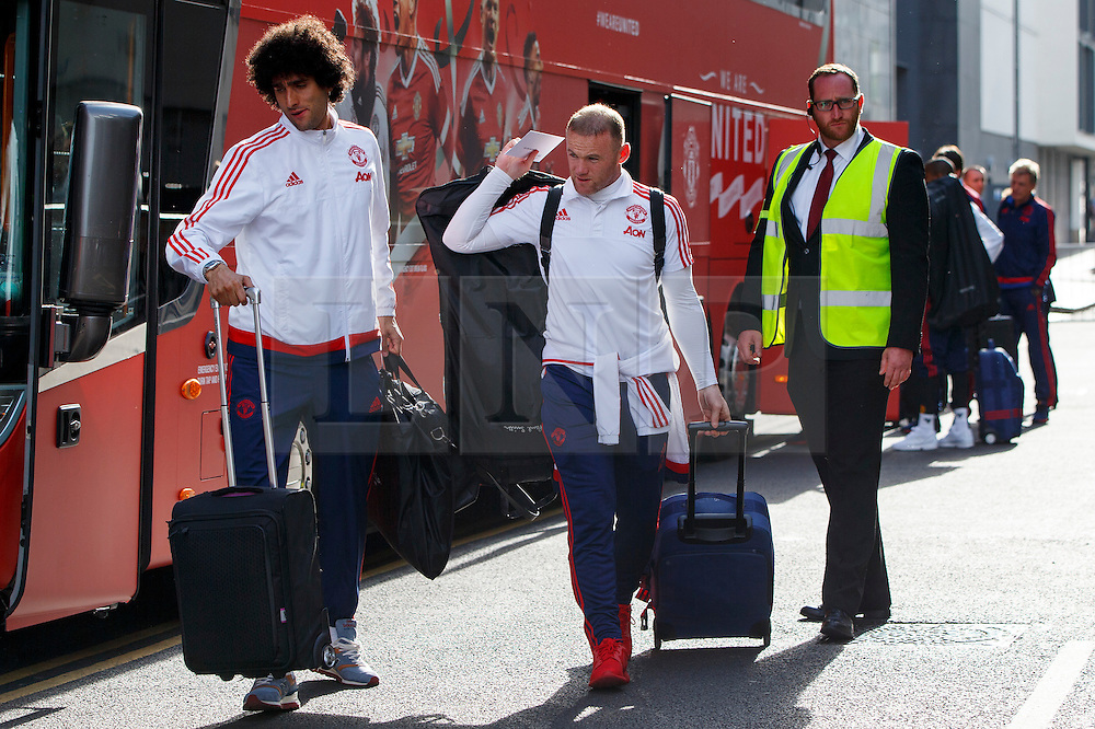 © Licensed to London News Pictures. 20/05/2016. London, UK. Manchester United players MAROUANE FELLAINI and WAYNE ROONEY arrive at their hotel in Wembley, London on Friday, 20 May 2016, ahead of the FA Cup final against Crystal Palace in Wembley Stadium. Photo credit: Tolga Akmen/LNP