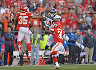 KANSAS CITY, MO - DECEMBER 01:  Safety Quintin Demps #35 of the Kansas City Chiefs intercepts a deflected pass intended for wide receiver Demaryius Thomas #88 of the Denver Broncos during the first half on December 1, 2013 at Arrowhead Stadium in Kansas City, Missouri.  (Photo by Peter Aiken/Getty Images) *** Local Caption *** Quintin Demps;Demaryius Thomas