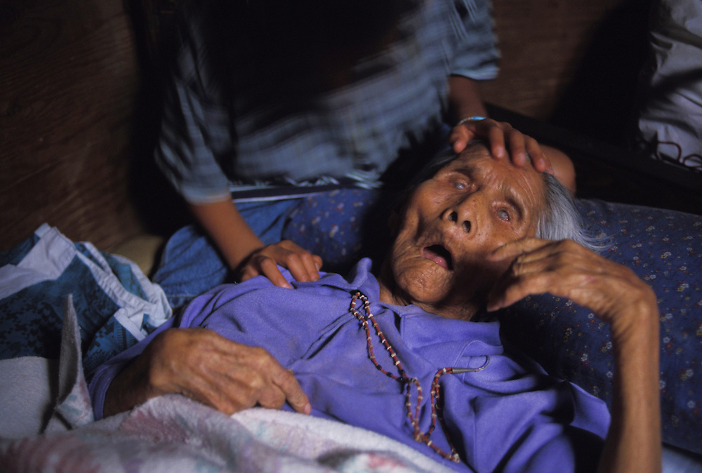Matriarch - Irene Yazzie, paralyzed by a stroke, is part of a family household where six generations live together.  Navajo society is matriarchal; one of a woman's principal responsiblities is to pass the land on to future generations, which is why many of the most vociferous resistors are women.