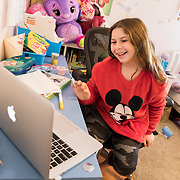 Brooklyn during virtual school that she attends from her bedroom.
