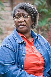 Portrait of an older woman sitting in the garden,