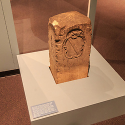 "A ""crownstone"" boundary marker of the Mason–Dixon line on display in the Pennsylvania State Museum in Harrisburg. These markers were placed every 5th mile along the line, ornamented with family coats of arms Maryland's Calvert family and the arms of William Penn."