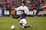 10 February 2006: US defender Todd Dunivant (front) tackles the ball away from a Japanese player. The United States Men's National Team defeated Japan 3-2 at SBC Park in San Francisco, California in an International Friendly soccer match.