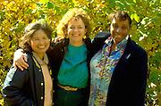 Multicultural neighborhood friends age 35 and 46 warmly enjoying a nice afternoon.  St Paul  Minnesota USA