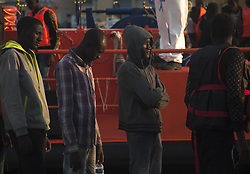 October 2, 2018 - Malaga, MALAGA, Spain - A group of migrants seen in a queue waiting to get in a tent of the Spanish Red Cross after their arrival at the Port of Malaga..Spain's Maritime Rescue service rescued 63 migrants aboard dinghies at the Mediterranean Sea and brought them to Malaga Harbor, where they were assisted by the Spanish Red Cross. More than 500 migrants have been rescued in one day. According to the Spanish nonprofit 'Caminando Fronteras' (Walking borders), 32 migrants and two children have died or disappeared at the sea, while trying to leave the Moroccan coast towards the Spanish coast on board a dinghy. 26 migrants survivor were rescued by the Moroccan gendarmerie. (Credit Image: © Jesus Merida/SOPA Images via ZUMA Wire)