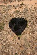 Balloon shadow against mesa floor