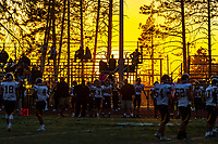 The sun sets behind the stands as the Paradise Bobcats play the Enterprise Hornets at home, Friday, November 1, 2019.<br /> Photo Brian Baer