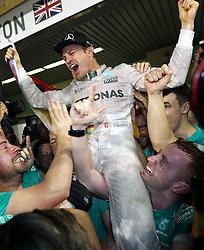 Mercedes' Nico Rosberg celebrates winning the Formula One world championship after the Abu Dhabi Grand Prix at the Yas Marina Circuit, Abu Dhabi.
