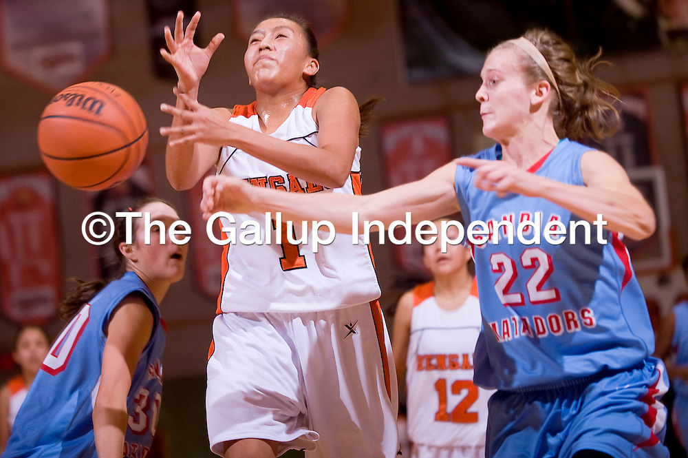 122212       Cable Hoover<br /> <br /> Gallup Bengal Rachelle Blackgoat (1) looses the ball as Sandia Prep Matador Astrea Reed (22) knocks it away Saturday at Gallup High School.
