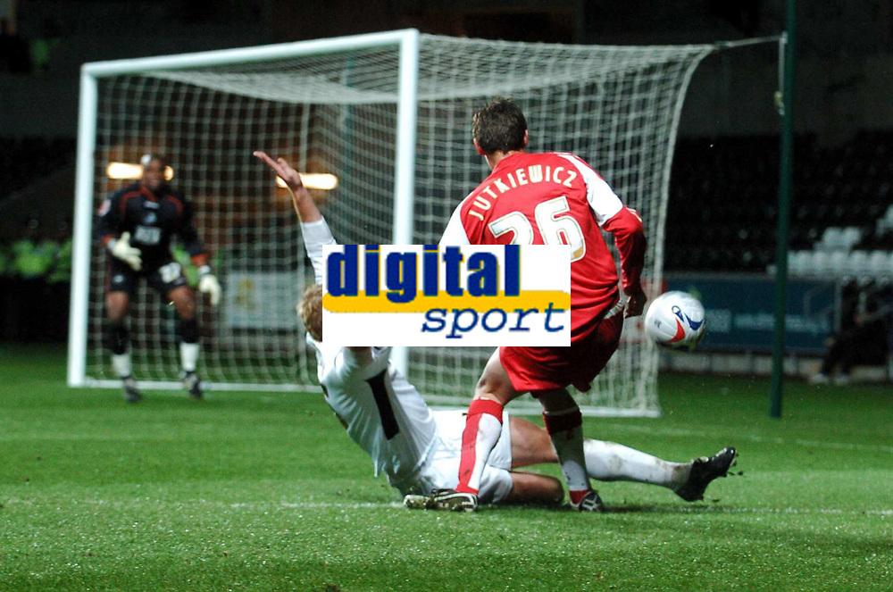 Photo: Adam Davies.<br /> Swansea City v Swindon Town. Coca Cola League 1. 11/04/2006.<br /> Swindon's Lucas Jutkiewicz and Swansea's Alan Tate.